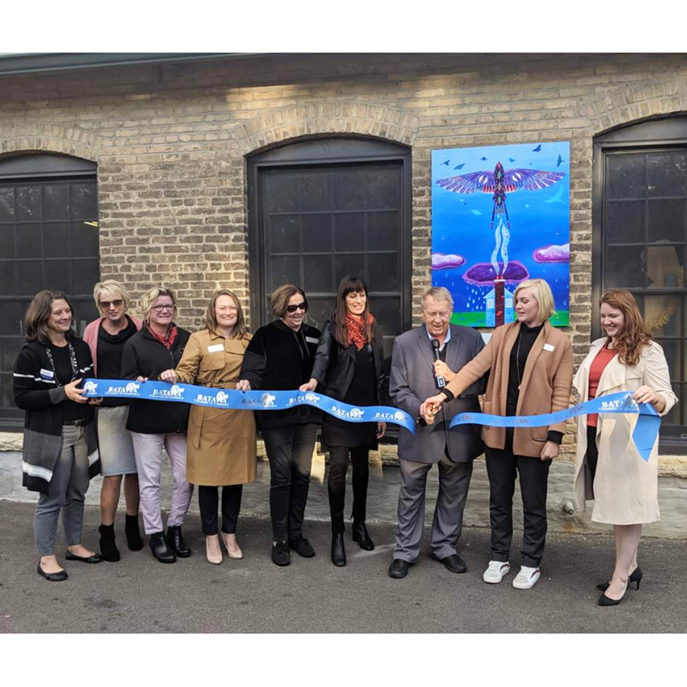ribbon cutting for new laura lynne art mural painting for domestic violence awareness in Batavia IL Chicagoland