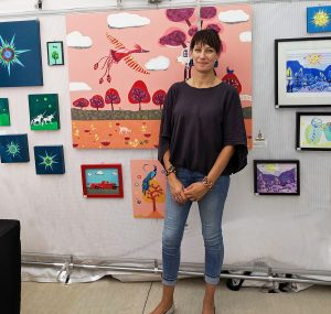 Laura Lynne Art with her paintings and mixed media work for sale in Chicagoland