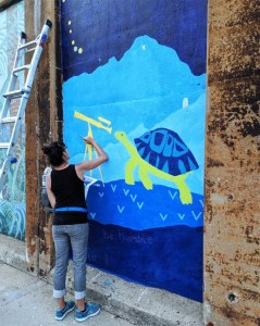 Laura Lynne Art working on Turtle Astronomer Mural and Inspirational quote in Oak Park, IL - Chicagoland