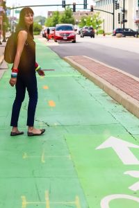 Portrait of artist Laura Lynne Art on bike trail in Aurora, IL