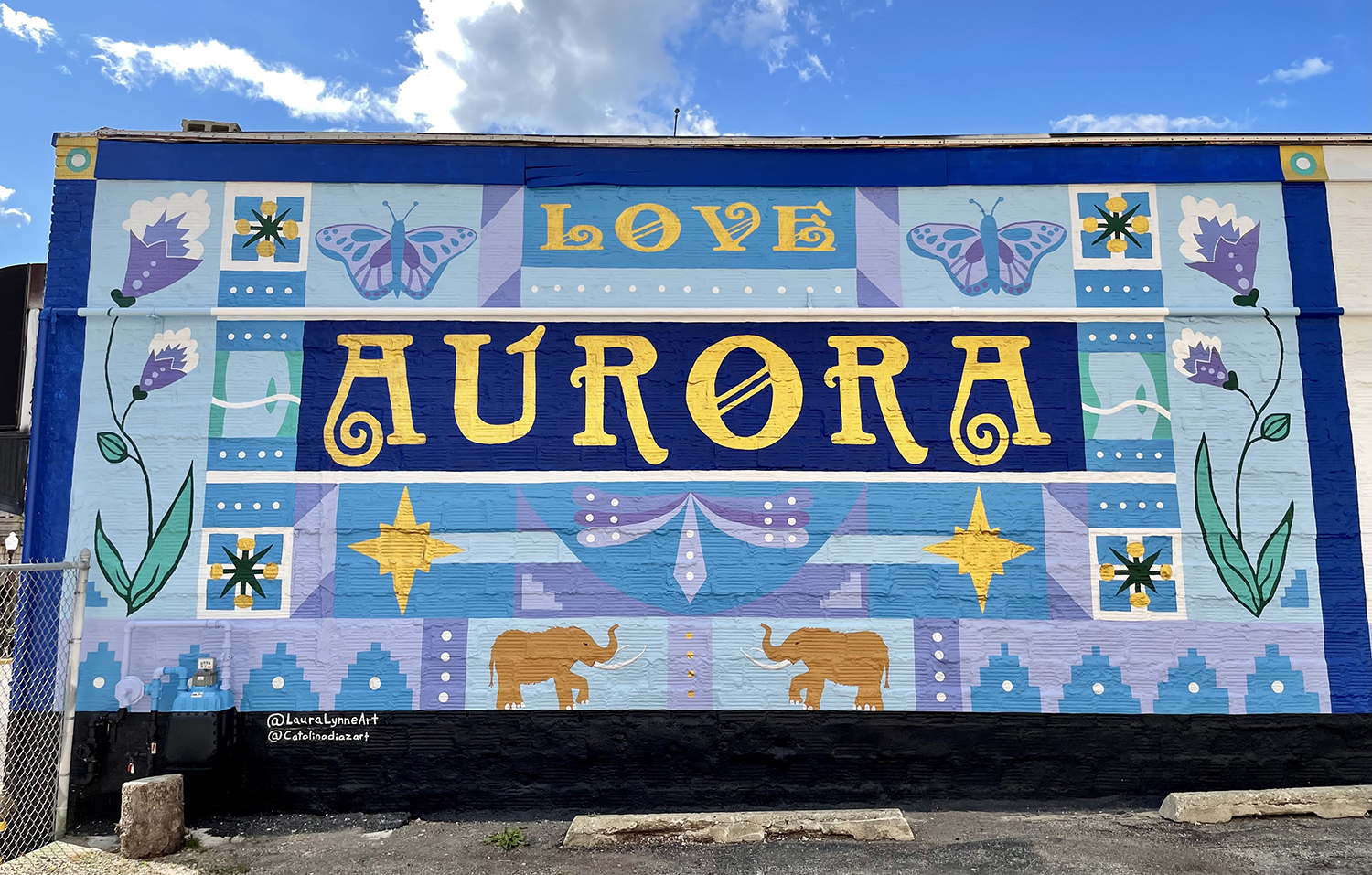 public community mural sign painting in aurora illinois by laura lynne art