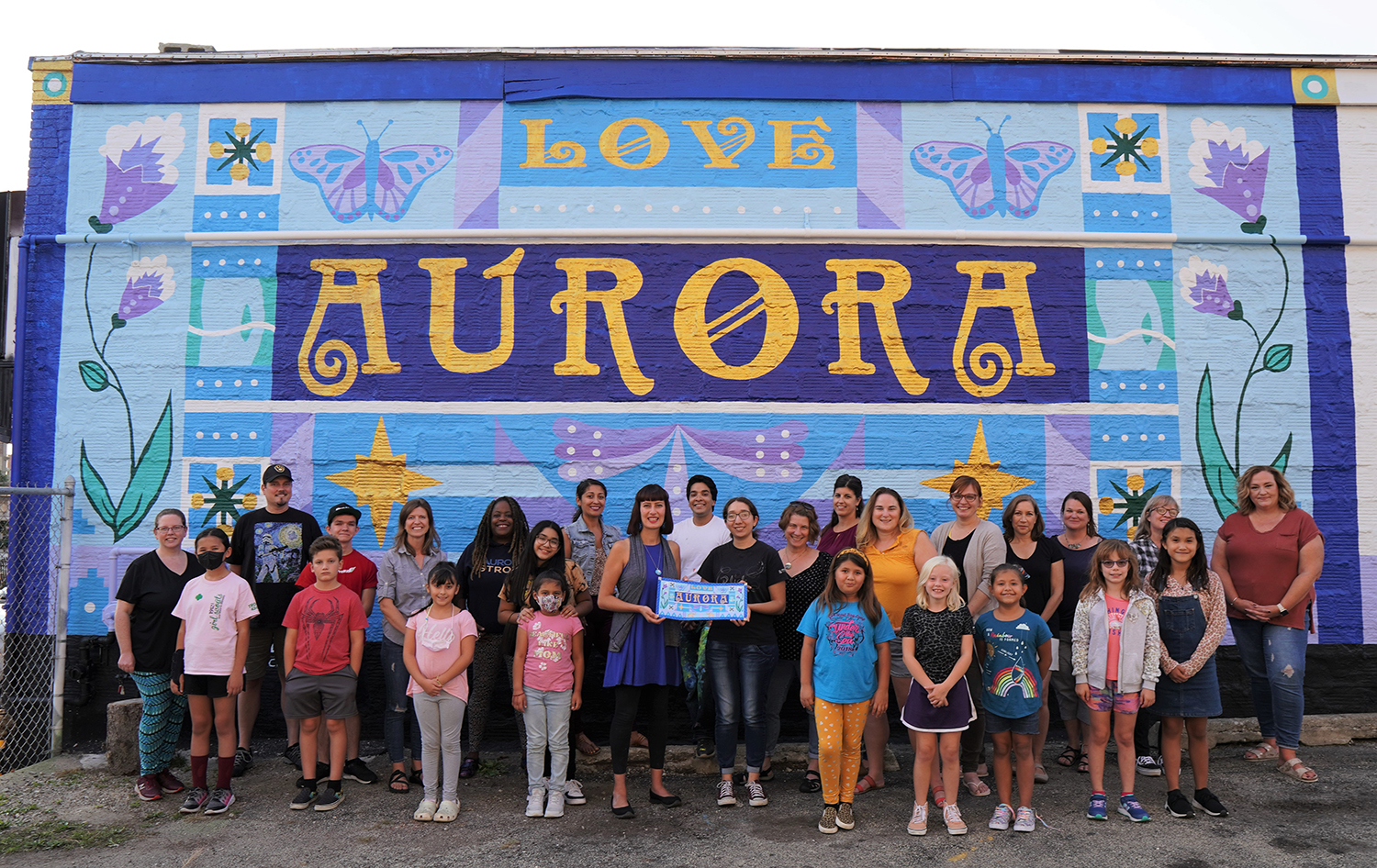 large mural painted by community volunteers in Aurora, IL lead by artists Laura Lynne & Catalina Diaz