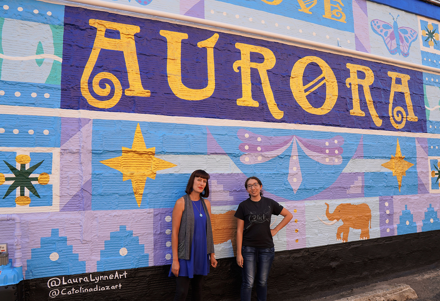 Laura Lynne Art and Catalina Diaz female artist team of the Aurora Unity Mural painting
