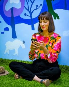 Relaxing space in employee break room with mural by Laura Lynne Art
